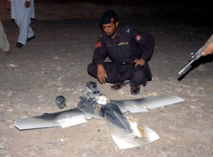 A Pakistani Army Artisan Officer examines the taxidermic techniques of the crashed Aquiline drone in Chaman 2012